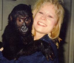 Lori is a professional dog trainer in Aurora, Colorado. Pictured here with a young monkey.